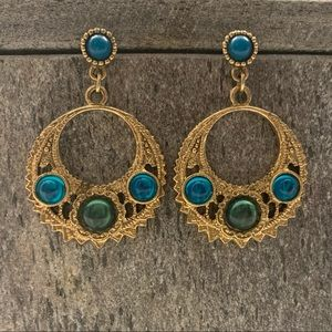 Statement blue- and green-studded earrings